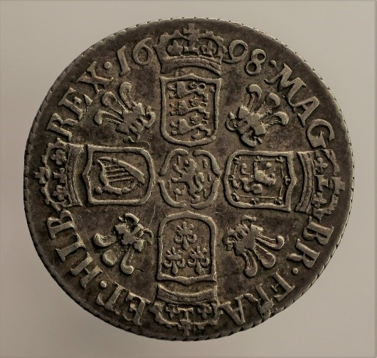 "Figure 7. Coin minted in 1698 with Welsh silver supplied by the ""Mine Adventurers"" a junior exploration-development company. The tactics used by this promotional company would make even a modern mining entrepreneur blush."